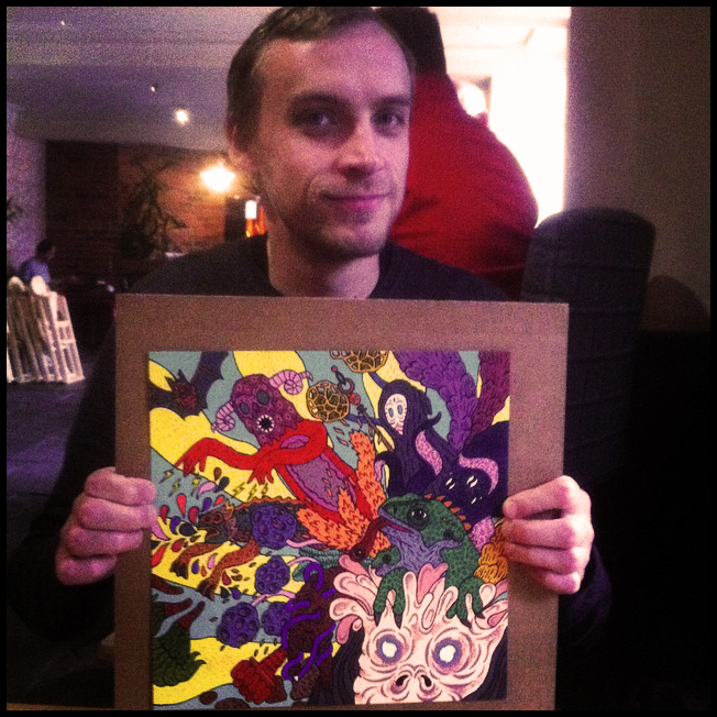Artist Jake Blanchard with the original painting.
